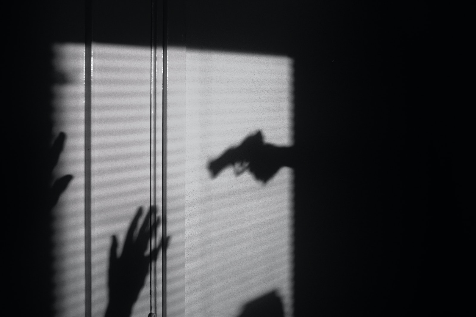 silhouette of person on window